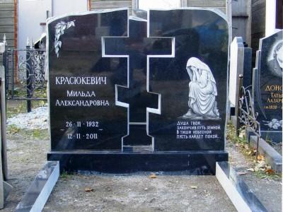 Элитный гранитный памятник с гравировкой скорбящей матери